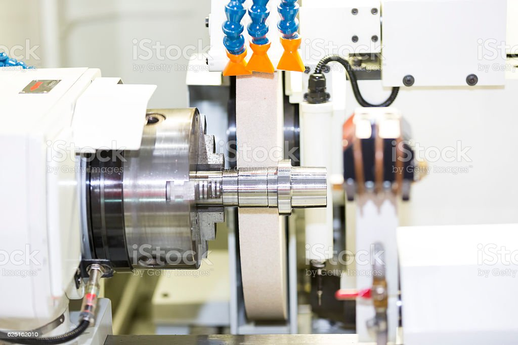 operator grinding mold and die part stock photo
