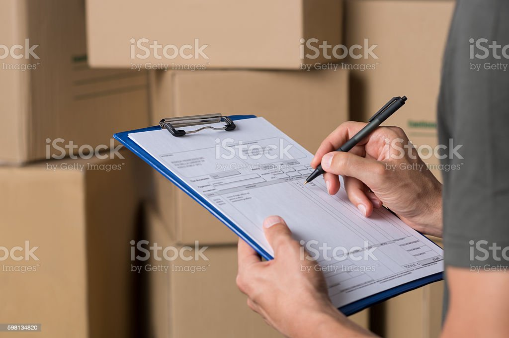 Operator in warehouse working stock photo