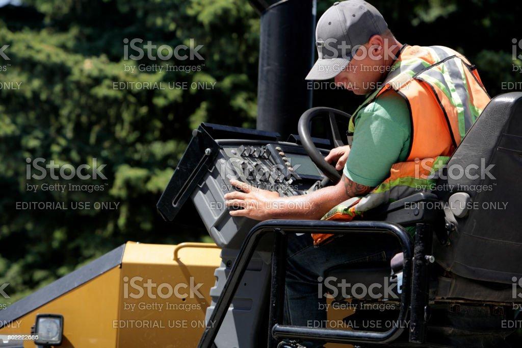 Operator Of Asphalt Paving Equipment stock photo
