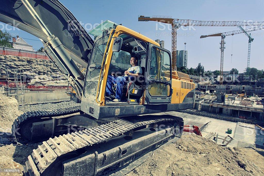operator operates with  excavator royalty-free stock photo