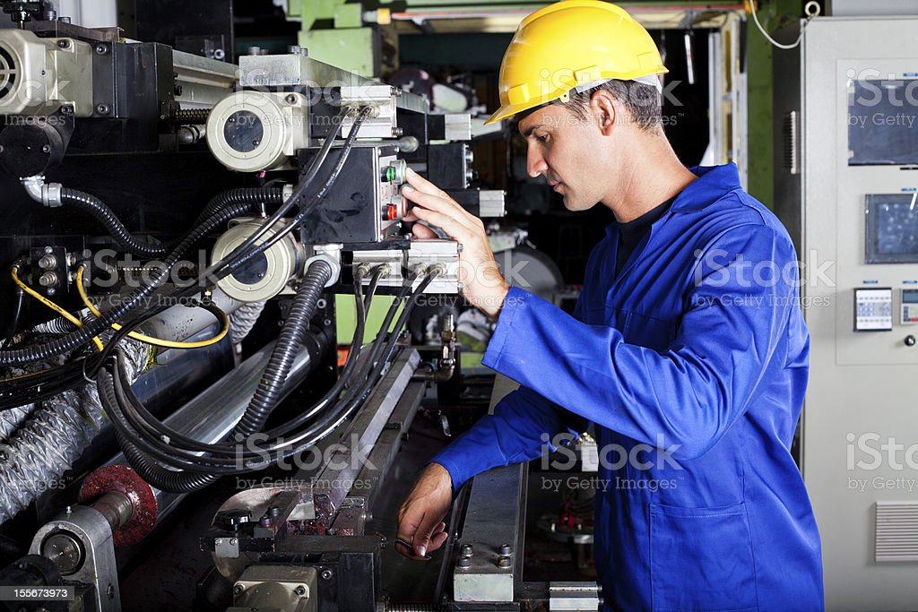 operator operating industrial printing press stock photo