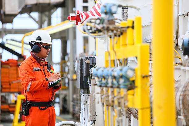operator recording operation of oil and gas process stock photo