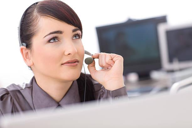 Operator talking on headset stock photo