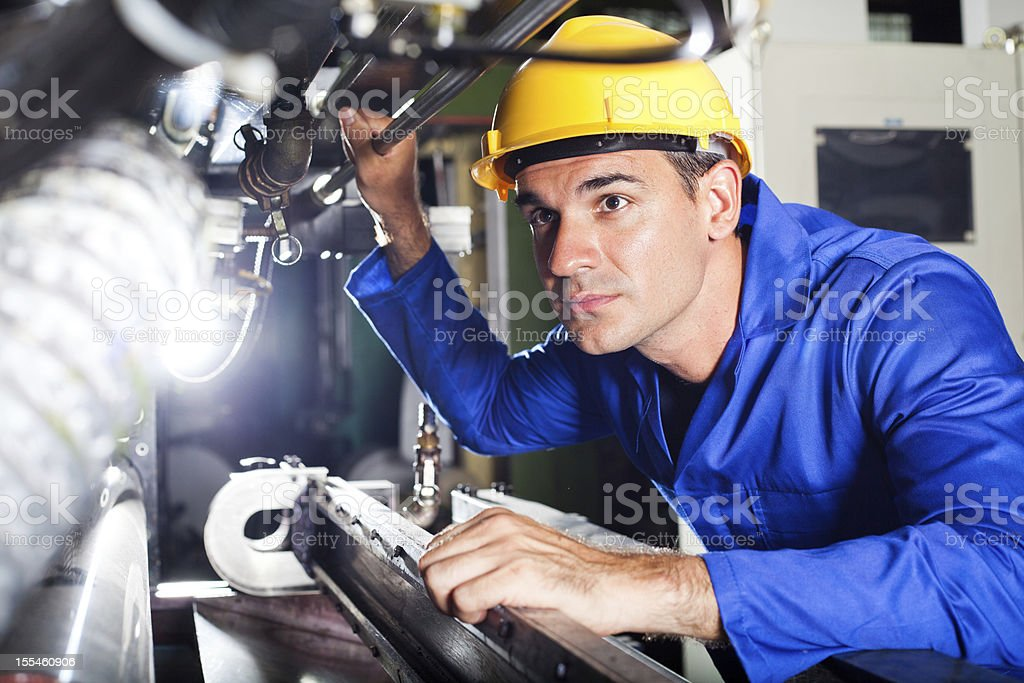operator working in factory stock photo