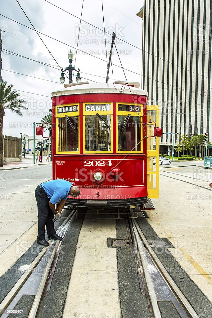 operator works on the streetcar at Canal street royalty-free stock photo