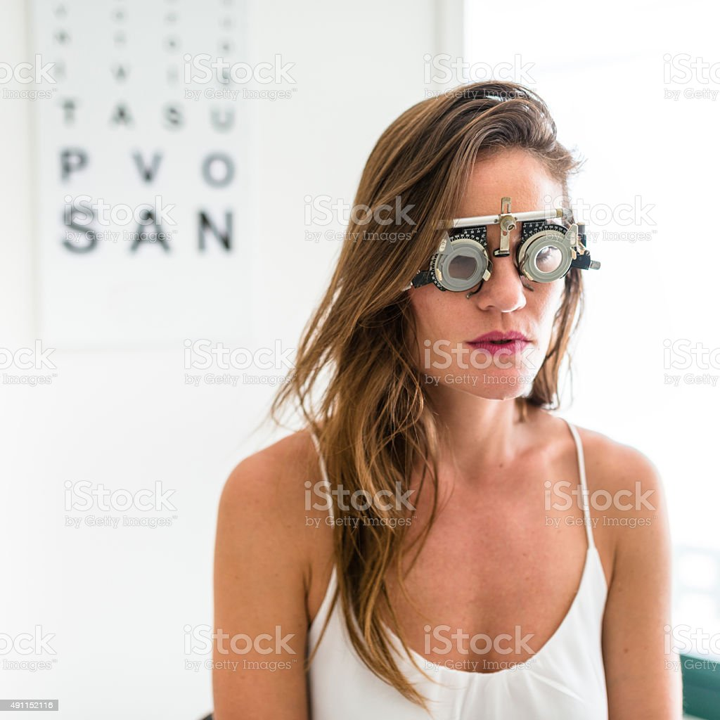 Ophthalmologist Doctor Looking A Phoropter Glasses Stock