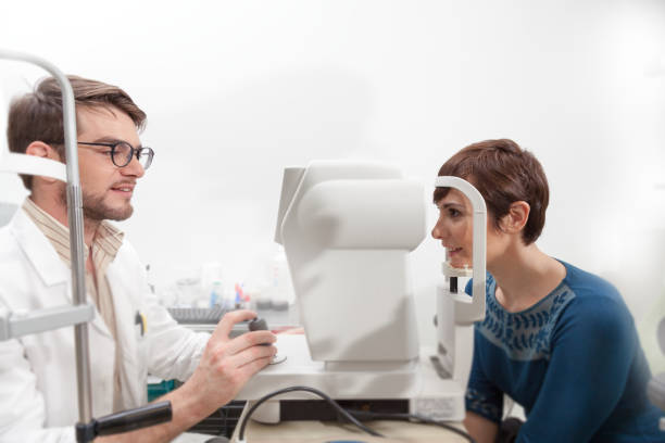 Ophthalmologist doing an eye control to a woman stock photo