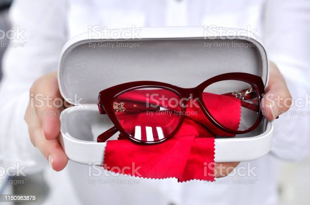 Ophthalmologist holding eyeglasses for a try out optometrist hands picture id1150983875?b=1&k=6&m=1150983875&s=612x612&h=qma2qpj9p8rwtqcjmoear8teoixlafcakhtgvwkwmay=