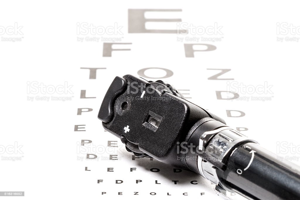 Ophthalmoscope is on a vison test stock photo