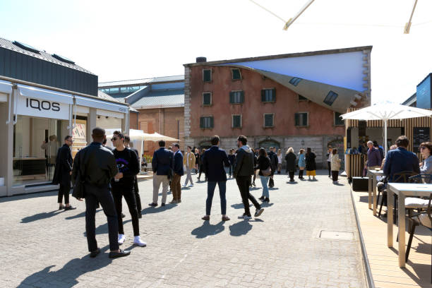 Opificio 31 in Tortona district, entrance. In background installation of Alex Chinneck  during Milan Design Week 2019: the Fuorisalone - Italy stock photo