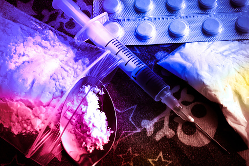 istock Opioid epidemic .Opioid Pills. Drug abuse Concept. Syringe preparation spoon and prepared the heroin. Stop the use of drugs. 905480866