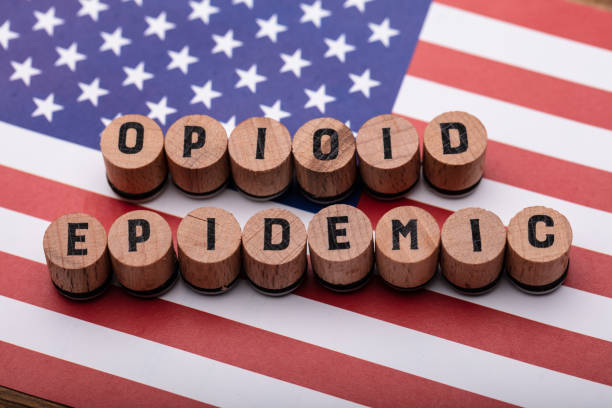 Opioid Epidemic Text On Cork Over American Flag stock photo