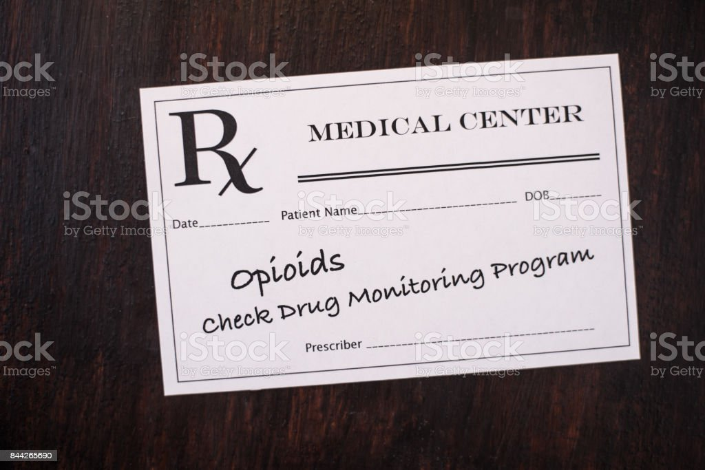 Opioid prescription with warning to check drug monitoring program stock photo
