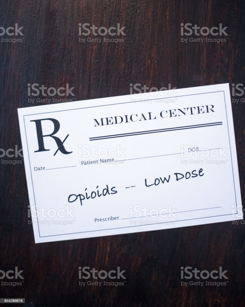 Opioid prescription with warning to prescribe low dose stock photo