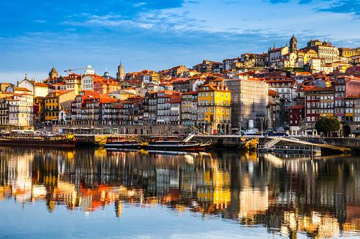 Oporto Ribeira reflections on Douro River, Portugal.