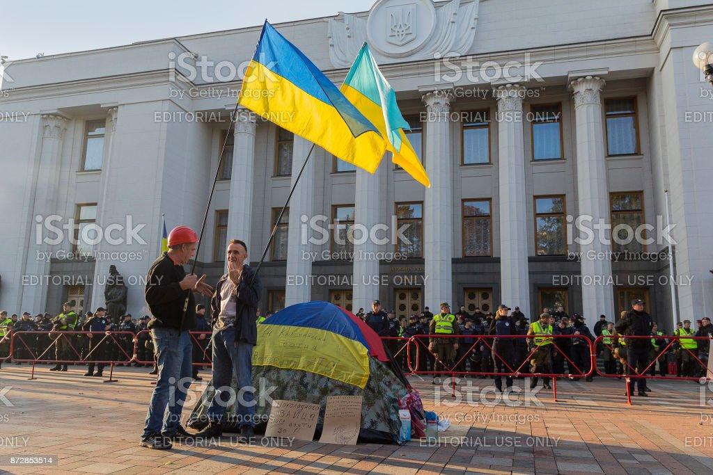 Opponents of the acting President Petra Poroshenko and the cordon alone in front of the Verkhovna Rada building of Ukraine stock photo