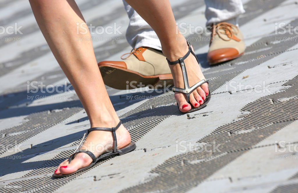 opposition about flip-flops and dress shoes stock photo