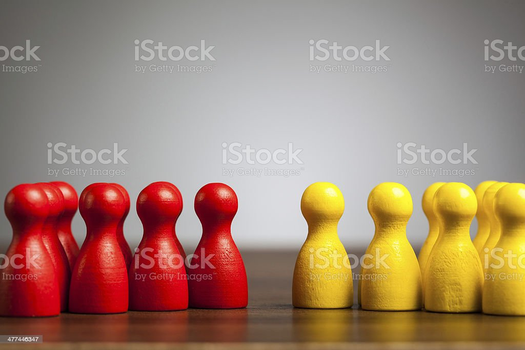 Opposition groups concept, toy pawn figures stock photo