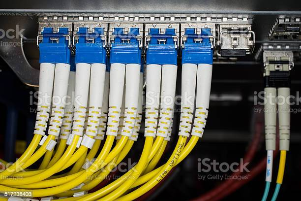 Optic fiber cables connected to data center picture id517238403?b=1&k=6&m=517238403&s=612x612&h=qoq5lcsrett9ez999uy9c9hpior6dejvgtm4rrl0ml4=