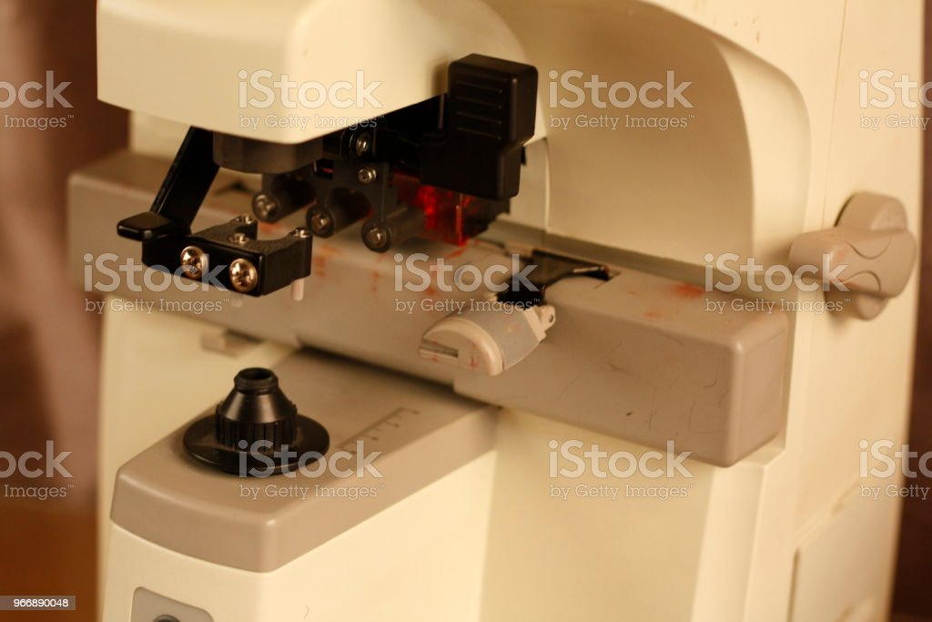 Optical dispensing epuipment being grinding prescription lenses in Australia stock photo