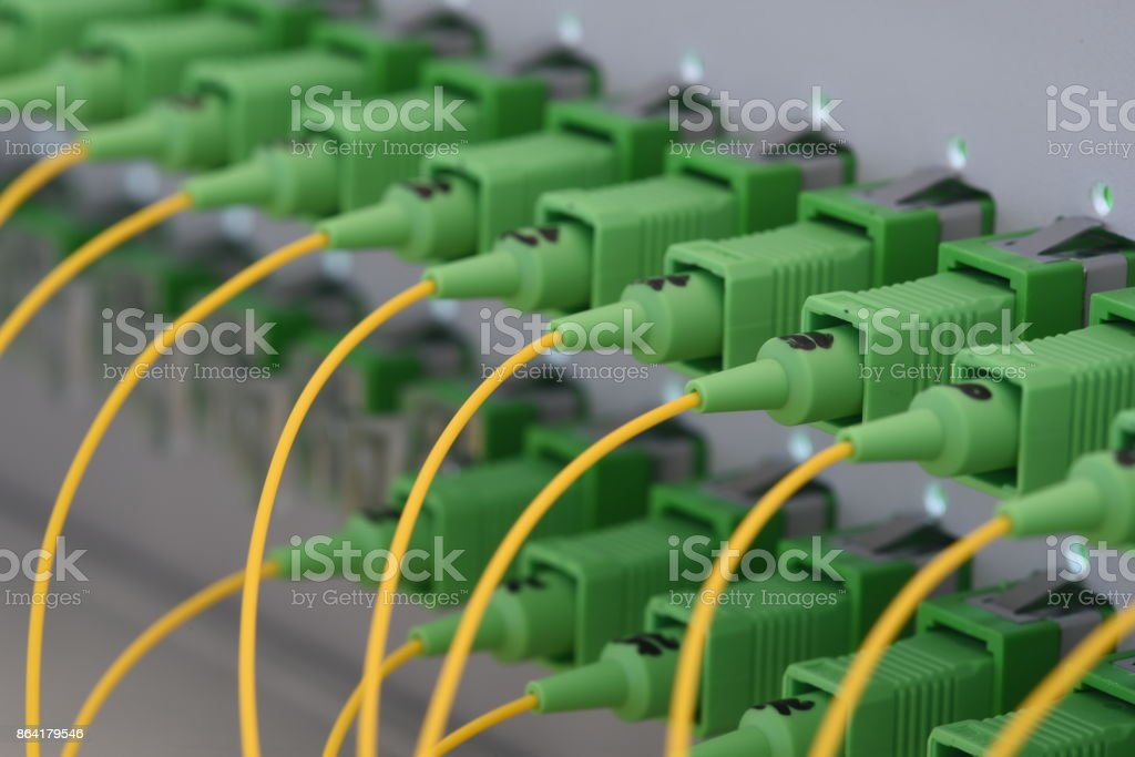 Optical fiber connector close up ans distribution frame panel royalty-free stock photo