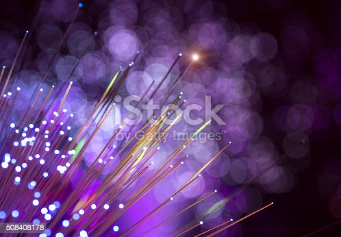 673622922 istock photo optical fibres dinamic flying from deep on technology background 508408178