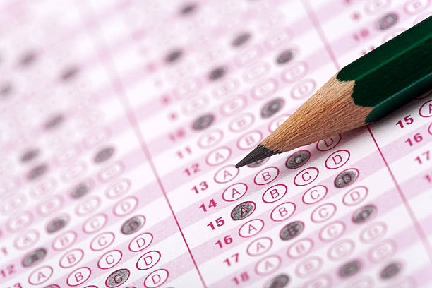 optical form of an examination with pencil and eraser optical form of an examination with pencil and eraser routine stock pictures, royalty-free photos & images