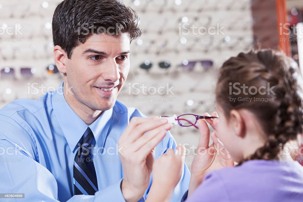 Optician helping a child royalty-free stock photo