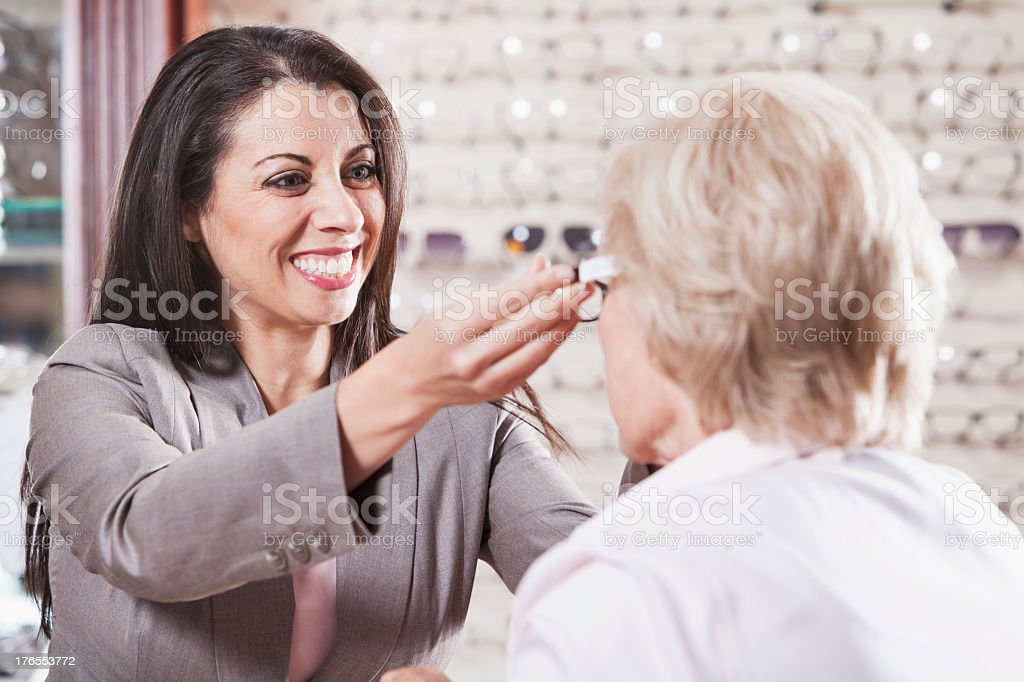 Optician helping a customer royalty-free stock photo