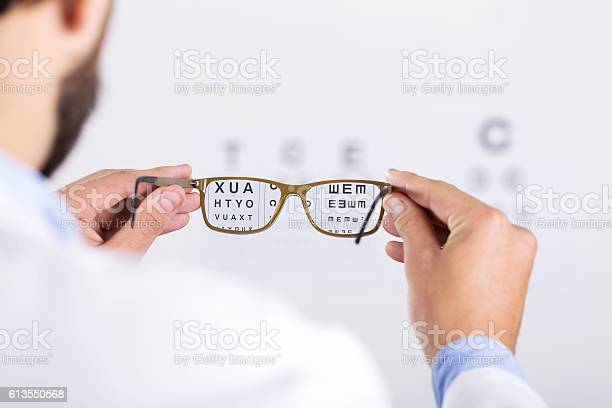 Optician holds glasses in front of eyesight test chart picture id613550568?b=1&k=6&m=613550568&s=612x612&h=2r c2384gmp5agpk6jfogebkhiycyq  6umvub3f59o=