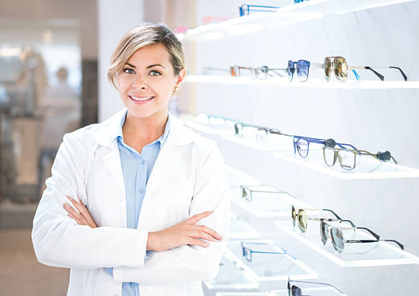 optician selling glasses at the optics - optometrist stock pictures, royalty-free photos & images