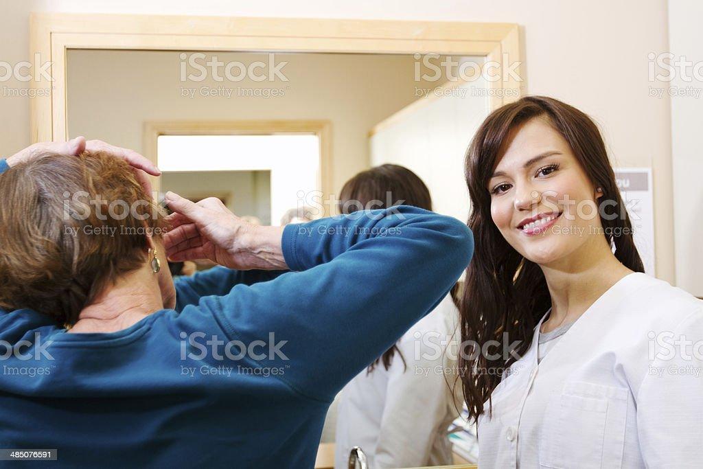 Optician with customer stock photo