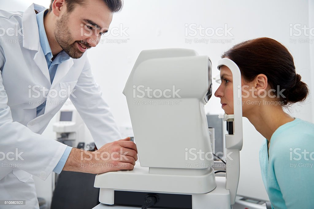 optician with tonometer and patient at eye clinic stock photo