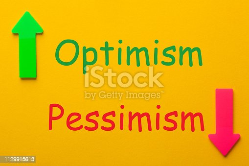 Optimism vs Pessimism with colorful arrows on a yellow background. Business Concept
