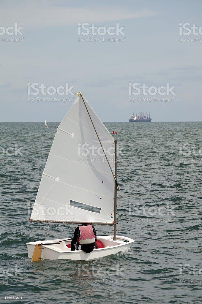 Optimist Sail and Shipping royalty-free stock photo