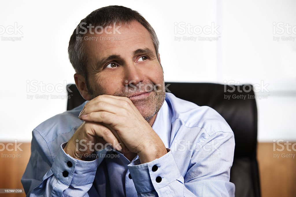 Optimistic businessman contemplating in office. royalty-free stock photo