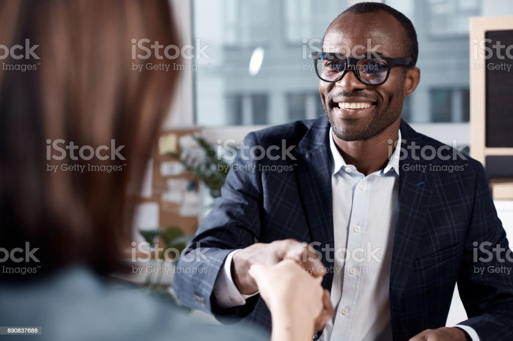 Optimistic qualified man is interviewing lady stock photo