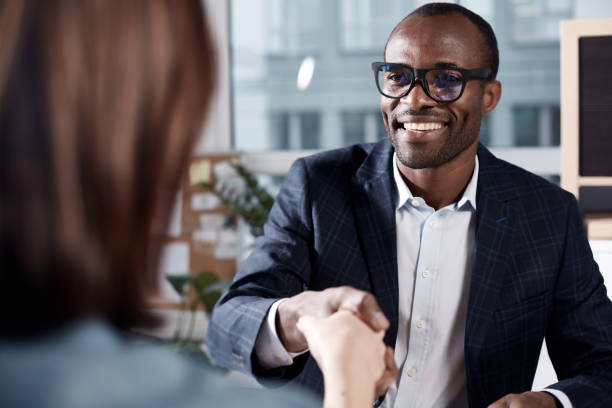 optimistic qualified man is interviewing lady - job interview stock pictures, royalty-free photos & images