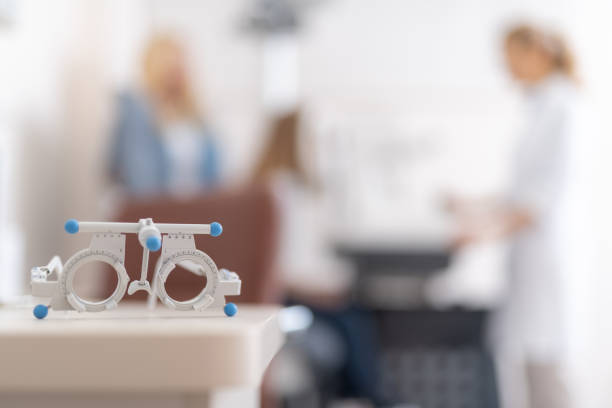 Optometric trial frame waiting for patient in modern ophthalmology clinic stock photo