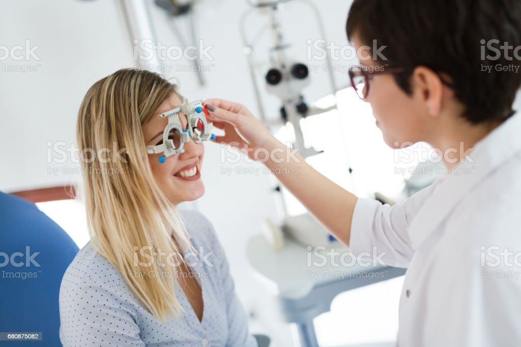 optometrist checking patient eyesight and vision correction royalty-free stock photo