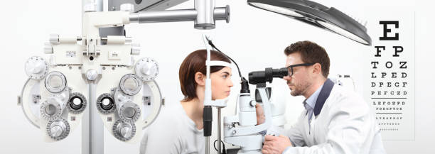 optometrist doing eyesight with woman patient measurement with slit lamp on white background - optometrist stock pictures, royalty-free photos & images