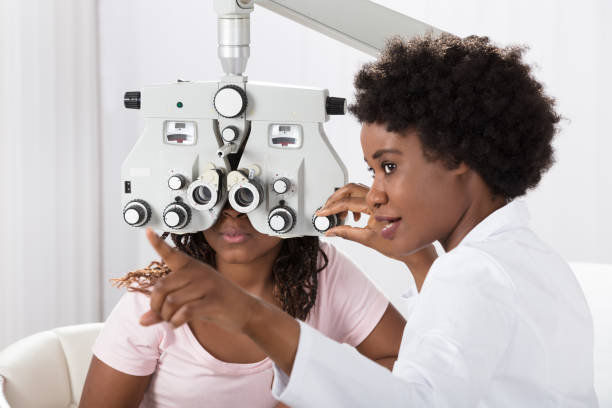 optometrist doing sight testing for patient - optometrist stock pictures, royalty-free photos & images