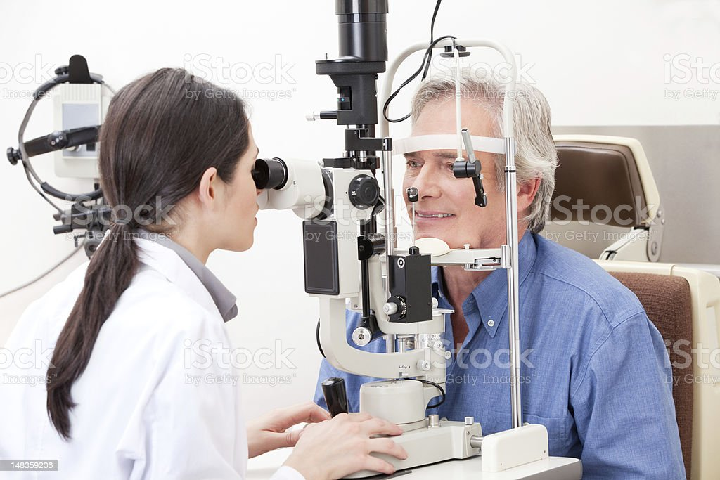 Optometrist doing Sight Testing stock photo