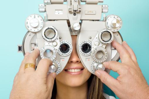Optometrist Eye Exam Phoroptor Stock Photo - Download Image Now