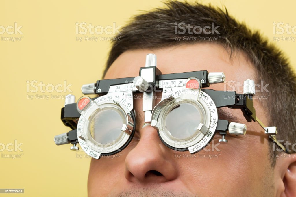 Optometrist Eye Exam Trial Frames Close up of a young man patient with trial frames. 25-29 Years Stock Photo
