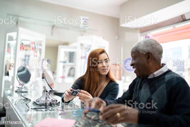Optometrist helping client trying on some glasses picture id1177429225?b=1&k=6&m=1177429225&s=612x612&h=uzm8eir3nv8wdi0luzcdofuqkbdgwdwb rp3ndbjhcs=
