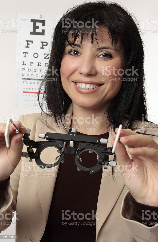 Optometrist holding trial frames royalty-free stock photo