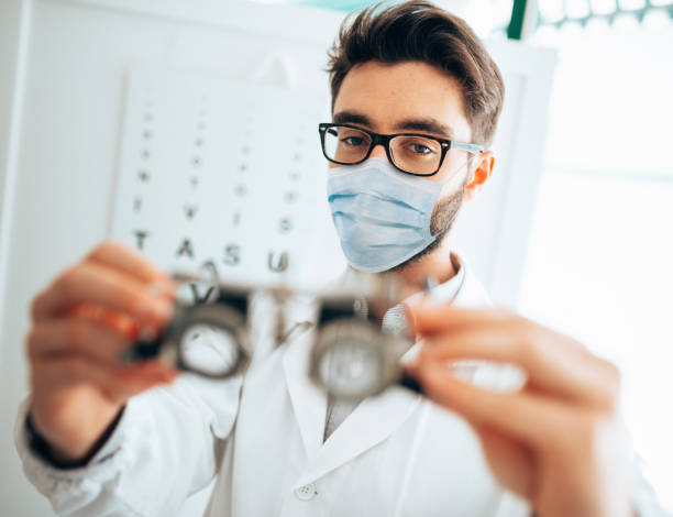 optometrist testing glass during the covid19 stock photo