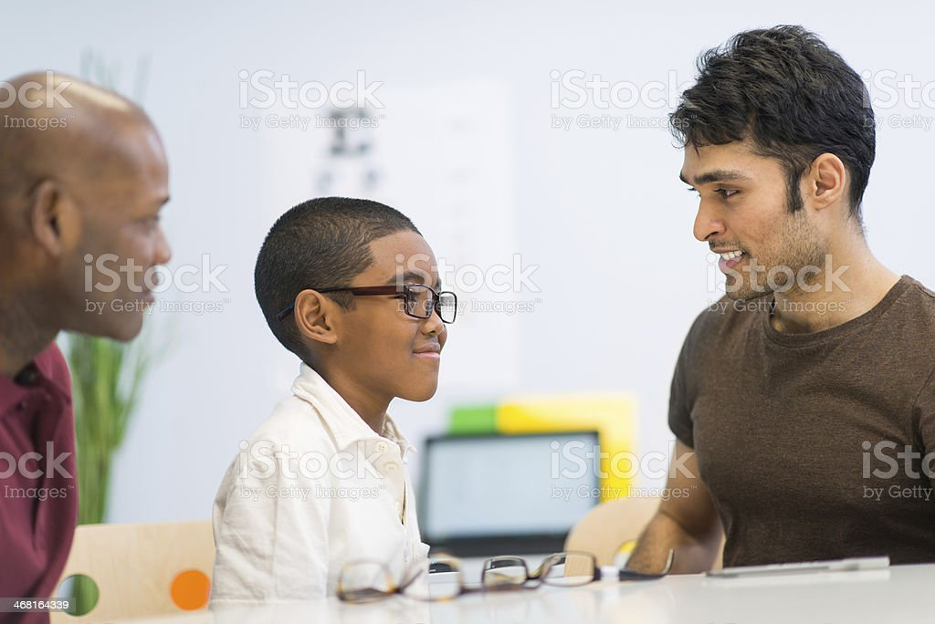Optometrist with patient stock photo