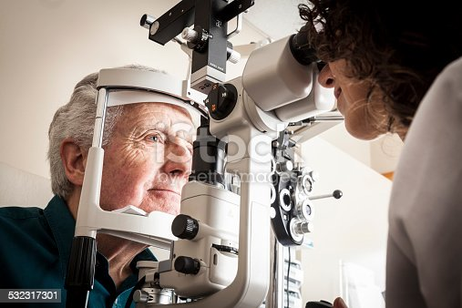 istock Optometrist with patient 532317301